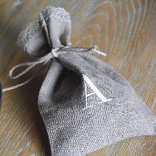 Customized linen lavender favor bag. Initial